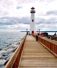 The spruce-and-maple-lined wooden boardwalk curves along the scenic Lake Huron shore, from Kiwanis Beach Park to American Legion Memorial Park.