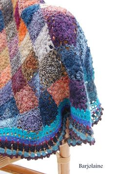 Crocheted Blanket. Looks so old fashioned and cozy