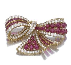 Beautiful Bow shaped Brooch embedded with Rubies and Diamonds