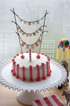 Simple cake, cute banner and beautiful cake stand!