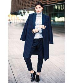 @Who What Wear - Doina Ciobanu of The Golden Diamonds   On Ciobanu: Mango coat and pants; Zara sweater; ASOS Marky Leather Brogues ($65).