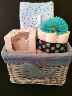 basket includes the following handmade items: 1 8 piece diaper cake 1 washcloth cupcake in gift box 1 oversized receiving blanket  Basket is reusable after shower. It is perfect for mommy to store diapers, socks, or bathtime materials!   Basket is premade so it is available for quick turnaround. gift basket is wrapped in cellophane with a blue bow.