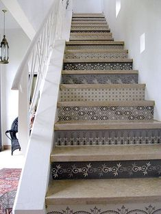 I would so do something like this. Paint my own art on the stairs. Of course the husband would have a cow. lol