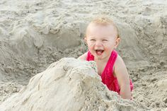 Portraits: Sandy sisters take on the beach. (Toddler playing in sand at the beach.) By Calm Cradle Photo & Design