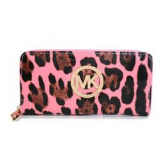 Michael Kors Leopard Smooth Pink Wallet  -Pink mirror leather upper.-Classic clutch design.-Cuboid shape. Golden hardware.-Zip around top with logo pull. -Package body with the Monogrammed Circle Logo. Golden MK logo studded on front center Inner several path pockets and card -pockets...