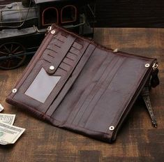 """PRODUCT DESCRIPTION Material: Excellent Genuine Leather Size: 8.5"""" x 5"""" x 1"""" inches Color: Coffee Color Gender: Unisex Style: Clutch, Wallet, Purse, Card Holder, Organizer - 2 Zippered Compartments Th"""