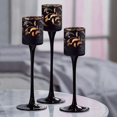 Spooky and sophisticated - keep a high-end Halloween theme high-end with Forbidden Fruits by PartyLite™ Vine Tealight Trio.