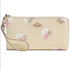 Coach NWT Floral Print Zip Wallet (Gold/Beechwood) BRAND NEW with tags 100% Guaranteed Authentic COACH Floral Print Zip Wallet  in Light Gold/Beechwood. Stunning for the upcoming Spring/Summer Seasons, with a vintage-inspired floral print and a slim, soft-sided design that unzips to reveal full-length bill compartments and 7 card slots. A zip closure keeps items securely tucked away, while a removable wrist strap keeps them close. Printed Coated Canvas. Color Light Gold/Beechwood throughout…