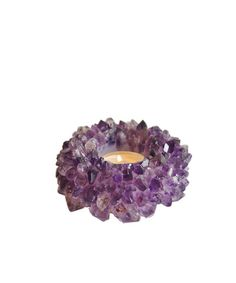 """Amethyst Quartz Votive Holder  $38.00  ◦ Purple Amethyst Quartz Votive Holder ◦ a stunning piece, perfect for holding a votive candle! ◦ use one on a bedside table, or a collection of quartz candle holders to create a marvelous centerpiece ◦ the amethyst quartz reflects the light so beautifully ◦ made in Brazil ◦ measures 4"""" wide x 2"""" high"""