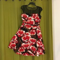 Tulip print dress New never worn A line dress that measures 24 in from belt to hem. This item is new and never worn but has no tags Liz Claiborne Dresses