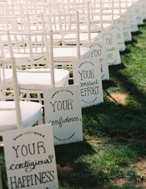 Cute signs along the wedding aisle instead of traditional pew decorations.