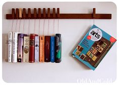 unique hanging bookshelf from etsy seller Old and Cold.  LOVE IT.