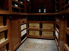 wine cellar with pullout storage space for cases