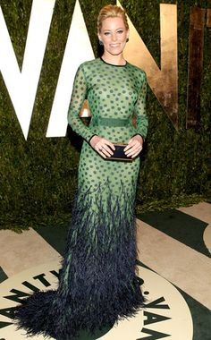 2012: Elizabeth Banks wore a green long sleeve Chadwick Bell gown with green polka dots and navy blue feathers on the bottom to the Oscars Vanity Fair after party. I actually like this gown! Elizabeth likes to go for unique and risky pieces. This gown is just that with mixing polka dots with feathers.
