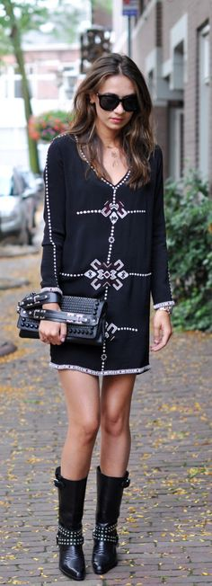 Kelly Elise is wearing a dress from Ba&sh and boots and clutch from Diesel