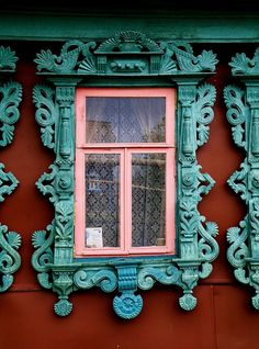 Traditional Russian window with carved shutters.