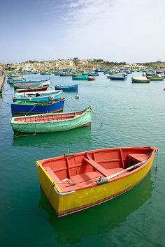 See the colourful fishing boats in the village of Marsaxlokk, Malta.