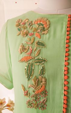 Description: Beautiful French knots and Zardozi Handwork on front Fine pintucks detail on one side at front A-line relaxed fit with elbow length sleeves Styling Tip: Pair with matching pants for a complete look. Zardosi Embroidery, Embroidery On Kurtis, Kurti Embroidery Design, Hand Embroidery Dress, Embroidery Neck Designs, Embroidery On Clothes, Embroidery Fashion, Embroidery Works, Bead Embroidery Patterns