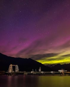 A Symptom of the Universe  Astrophotographers on the dock at Porteau Cove capturing a very active Aurora Borealis over the Howe Sound. Throwback to Porteau Cove Provincial Park Squamish-Lillooet British Columbia Canada  May 7 2016