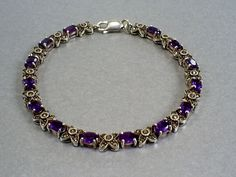 Sterling silver, marcasite and amethyst tennis bracelet.