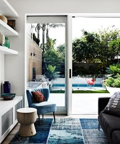 Inside and out blend into one, thanks to generous glazing and the deck and floor sharing the same level. Photo: Sharyn Cairns   Story: Real Living