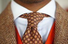 Men's brown/beige herringbone jacket with orange vest & contrasting tie