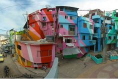 This is the center square of Santa Marta, a community in the heart of Rio de Janeiro, after a facade make-over by Favela Painting.    Started by Dutch designers Jeroen Koolhas and Dre Urhahn, the Favela Painting projects aim to bring works of art to the slum neighborhoods of Brazil. What a fabulous blend of colors!
