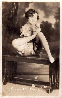 """Frances O'Connor, armless sideshow act billed as """"The Living Venus de Milo"""" balances a ball on her toes. She was 16 years old in this photo postcard from 1938 Denver, Colorado Sells-Floto circus season."""