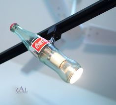 Track lighting from Etsy shop Strip Lighting, Track Lighting, Lighting Ideas, Spray Bottle, Beer Bottle, Reuse Old Tires, Reuse Recycle, Upcycle, Coca Cola Decor