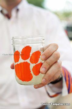SOOOOO making these Tiger paw mason jars for football season and tailgates!