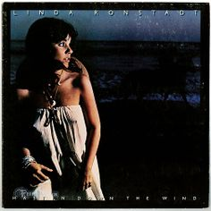 """""""Hasten Down The Wind"""" was Linda Ronstadt's third straight million-selling album. Ronstadt was the first female artist in history to accomplish this feat. For this album, she chose to showcase new songwriters, including songs from Warren Zevon (""""Hasten Down the Wind"""") and Karla Bonoff (""""Someone to Lay Down Beside Me""""); both of whom would soon be making a name for themselves. A reworking of Patsy Cline's classic """"Crazy"""" was a Top 10 Country hit for Ronstadt. (Vinyl LP)"""