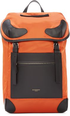 Nylon backpack in orange with leather trims and details throughout in black. Top carry handle. Flapover at top with pin-buckle closure straps. Front zippered patch pocket. Logo stamp in gold-tone at bag front. Reinforced bottom corners. Drawstring at bag throat. Adjustable padded shoulder straps. Fully lined in black textile. Zippered pocket at interior. Tonal stitching. Approx. 10