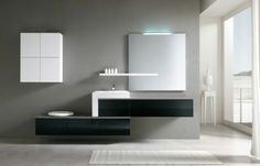 salle de bains minimaliste avec des meubles suspendus en noir et blanc