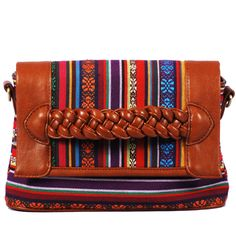 Vieta Pink Zamora Sunset Purse. A rainbow of colors in a southwestern print. This purse has so much happening on it's own that I would style it down with a simple v-neck t-shirt and jeans. #vieta #purse