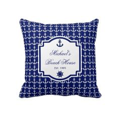 """Ship's Anchor Navy Blue Nautical Pillow  Decorating your beach house has never been easier than with our colorful nautical-styled pillows with a repeat pattern of ship's anchors in the background overlayed with an emblem for your text that is also overlayed with a ship's anchor and a ship's wheel. Available in several colors, you're sure to find something to enhance your decor. Text colors, styles and font sizes can be changed by clicking """"Customize."""""""