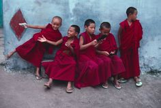 Young monks play with computer games in Sera Monastery in Bylakuppe, India, 2001. Steve McCurry