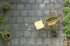 Running bond large grey square brick patio