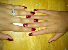 Matching mommy and daughter nails Cadillac red with black stripe . . . It is not easy to paint her nails seeing as she has epilepsy and shakes quite often