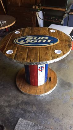 Wooden Spool Bud Light Table, Great for the garage club ! :) Wooden Spool Bud Light Table, Great for the garage club ! :) Wooden Spool Bud Light Table, Great for the garage club ! :) Wooden Spool Bud Light Table, Great for the garage club ! Wooden Spool Tables, Cable Spool Tables, Wooden Cable Spools, Cable Spool Ideas, Reclaimed Wood Furniture, Recycled Furniture, Bar Furniture, Furniture Projects, Wood Projects