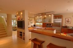 asian kitchen by Archipelago Hawaii, refined island designs - built ins to open up wall between kitchen/living room