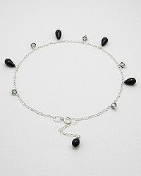 Sterling silver anklet decorated with cz teardrops.