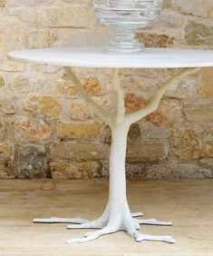I chose this furniture because I like the look of it. I think it looks very interesting and organic. It looks natural and it is not just a table but a conversation starter as well.
