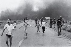 "The Terror of War by Nick Ut - - 1972 - SOUTH VIETNAMESE AIR FORCE MISTAKENLY DROPPED A LOAD OF NAPALM ON THE VILLAGE.  THE LITTLE GIRL WITHOUT CLOTHES HAD BE HIT AND SHE WAS SCREAMING,""TOO HOT!  TOO HOT!  A AMERICAN TOOK HER TO AN AMERICAN FACILITY FOR TREATMENT WHICH SAVED HER LIFE."