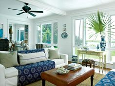 White paint updates brick walls and ceiling beams in this coastal South Carolina home. The furnishings and textiles channel a French country look with antiques and an array of printed fabrics. (Photo: Deborah Whitlaw Llewellyn)