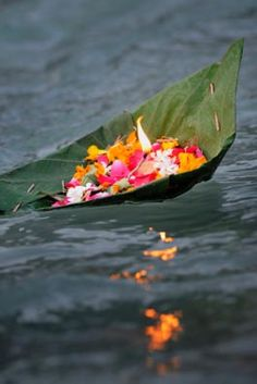 "Puja. The word Puja is an ancient Indian word which means ""to worship with flowers."""