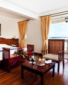 Victoria Chau Doc Hotel  ( Chau Doc, Vietnam )  Each of the 92 rooms has gleaming hardwood floors and handsome colonial furniture (Deluxe). #Jetsetter