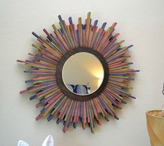 s 11 totally unexpected ways to fill your blank walls in minutes, repurposing upcycling, wall decor, Craft a Colorful Mirror from Wood Shims