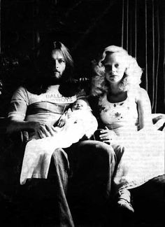 """Pink Floyd's David Gilmour and wife Virginia """"Ginger"""" Hasenbein pose with newborn daughter Alice (1976)"""
