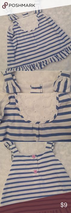 Precious little a line blue and white striped top! This adorable Gymboree little top has a ruffle at the bottom and cute little bows on the shoulder! It has no signs of stains or tears and is super adorable with white leggings or ruffle bottom pants! This has always been washed in Dreft! Cute little pink/purple colored buttons on the back. Gymboree Shirts & Tops