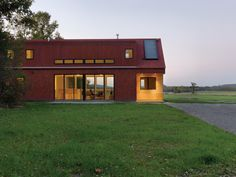 """""""Like the old farmhouses and barns of the Champlain Valley, the Foote Farm House has a clearly ordered wood frame on a sturdy foundation, an exterior skin made of local materials, an economy of form with tried-and-true proportions, a central fire place, and a common-sense relationship to the sun and the weather."""" - Architect John McLeod"""